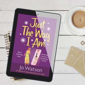Book image of Just the Way I am, on Kindle, with cup of coffee